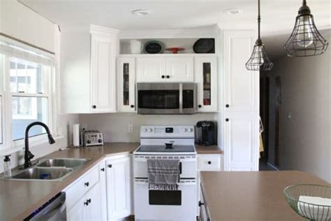 spray kitchen cabinets how to spray paint cabinets like the pros bright green door