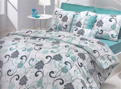 white and teal bedding modern bedroom interior with teal white grey swirl