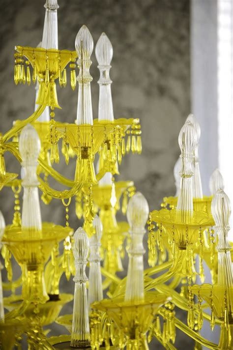 Bold Decor Idea: yellow chandelier against black walls and