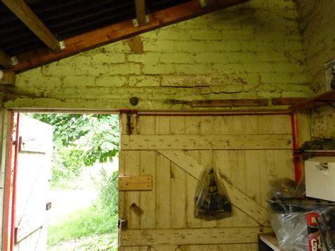 Replace rotten wooden lintel over garage door   Garages