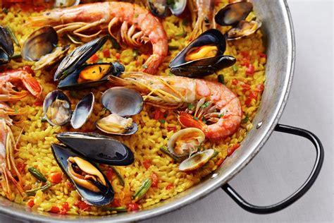 come cucinare la paella ricetta paella di pesce non sprecare