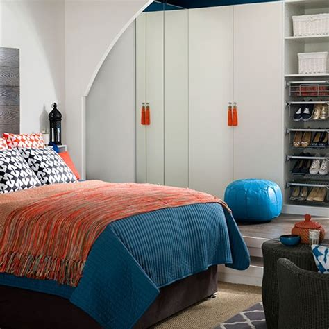white bedroom with orange and blue accents bedroom