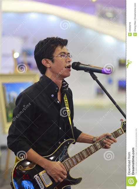 male singer with guitar on direct tv commercial foreign male singer with electric guitar editorial stock