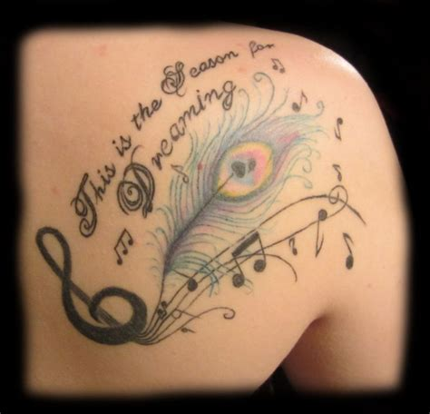 feather tattoo shoulder blade back tattoo peacock tattoo feather tattoo music tattoo