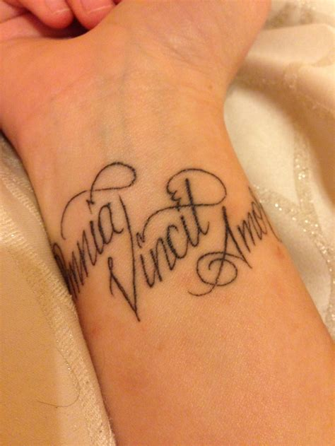love conquers all tattoo quot omnia vincit quot wrist conquers all in