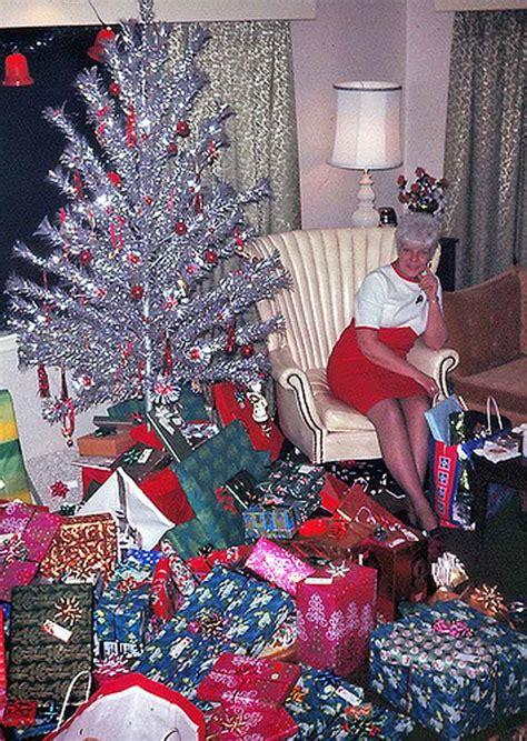 mid century women enjoying aluminum christmas trees flashbak