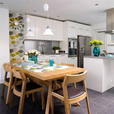 white and yellow kitchen ideas white kitchen with retro yellow green and blue wallpaper