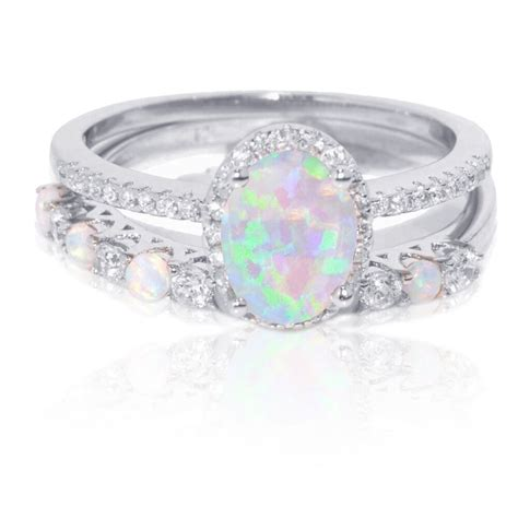 oval white fire opal thin simulated diamond engagement
