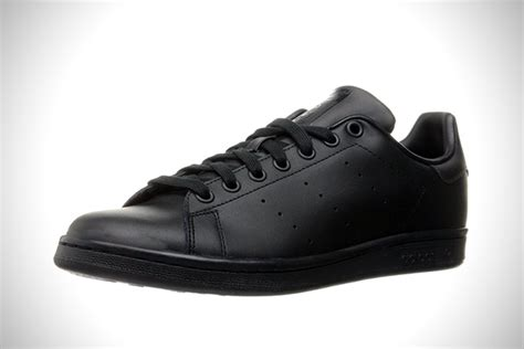 blacked out 15 best all black sneakers for