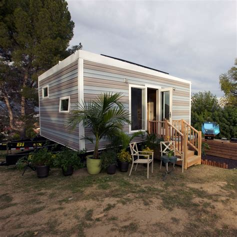 fyi network tiny house phillise and sons were able to get the eco friendly tiny house with three solar