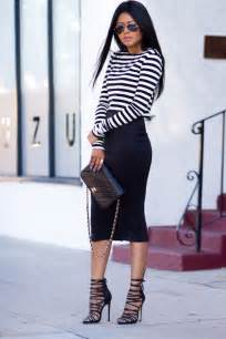 Black moto jacket casual black tee red skirt and leopard booties