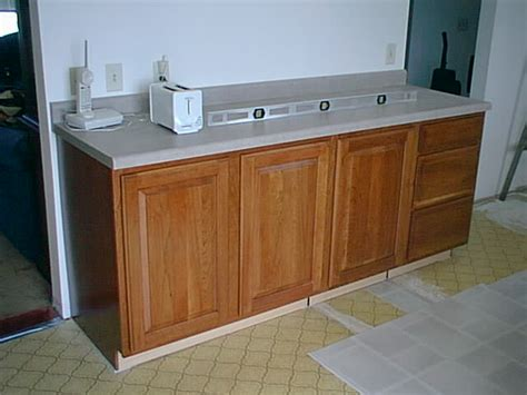 how to level kitchen base cabinets how to level kitchen