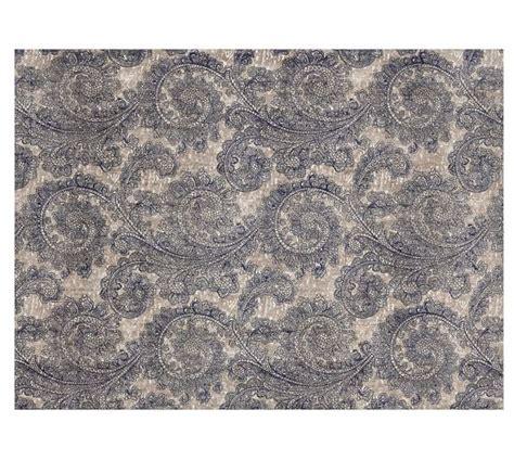 sheepskin rug cappuccino pottery barn ravati paisley printed rug blue pottery barn