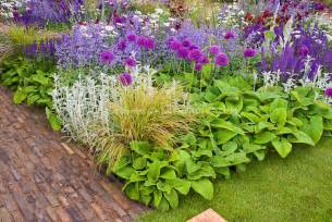 beautiful flower bed border garden with mixed bulbs