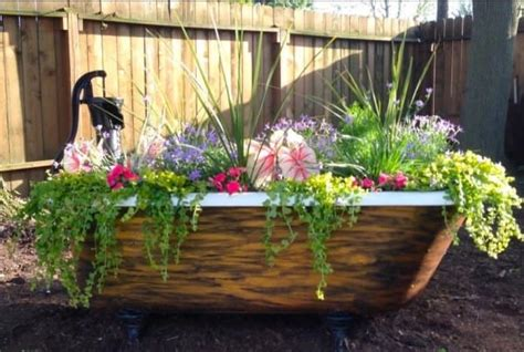 bathtub planter she found this rusty old tub in a heap of junk what she