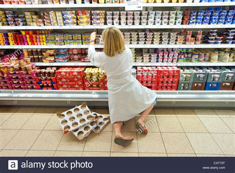 Shelf Shopping by Dairy Products On A Shelf In A Supermarket Refrigerated