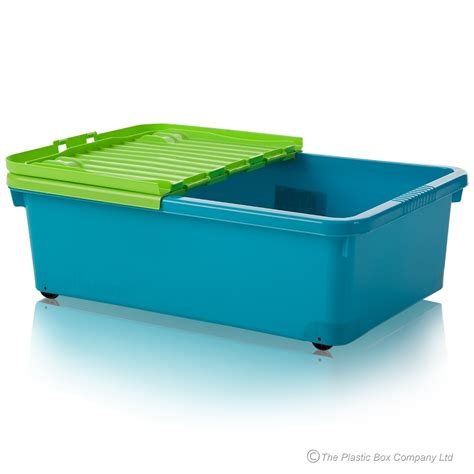 plastic under bed storage buy 32 litre under bed plastic storage box with folding lid and wheels