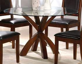 simple round glass top dining tables with wood base and