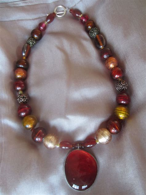 large glass bead necklace rust and gold glass bead handcrafted necklace with pendant