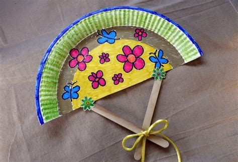 how to make paper fans on a stick how to make a paper plate fan thriftyfun