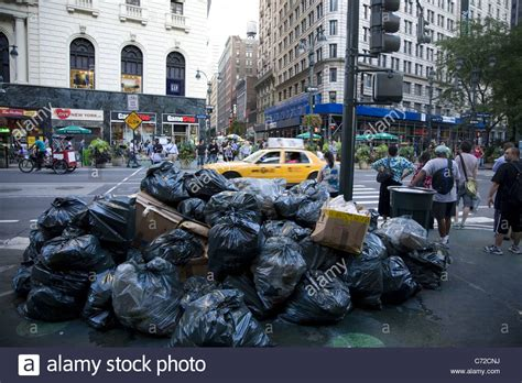 The City Digs Through Nyc Trash by Garbage Piled Up On The On Broadway Near 34th St