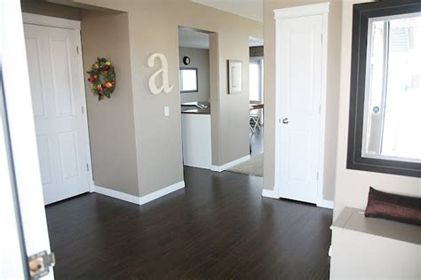 wood floors white trim and doors wall color it s