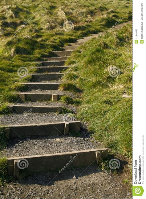 Up The steps leading up the grassy hill royalty free stock