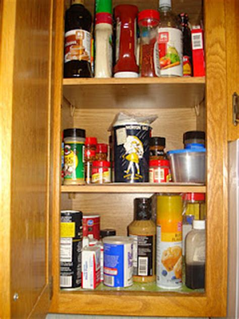 organizing kitchen cabinets and drawers of fame