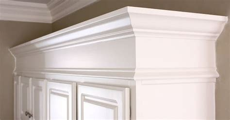 the yellow cape cod painting kitchen cabinets painted the yellow cape cod making cabinets taller builder