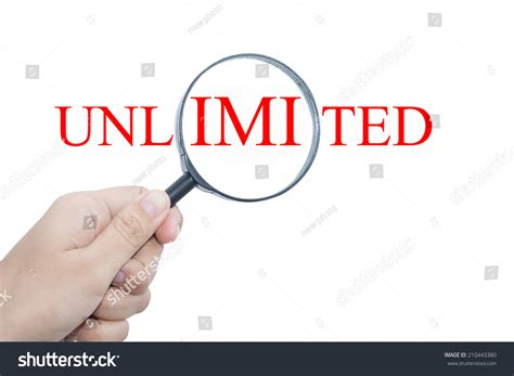 hand showing unlimited word through magnifying glass stock