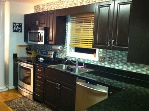 transforming kitchen cabinets dark brown cabinets with black countertops love