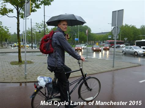 cycling rain mad cycle lanes of manchester cycling in the rain