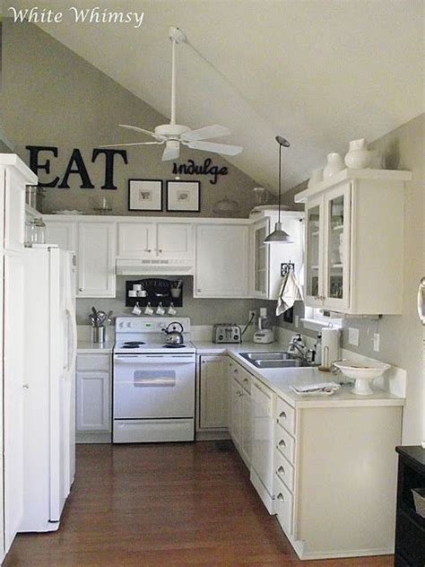 light gray kitchen cabinets with white appliances ideas to decorate a kitchen with painted cabinets in light
