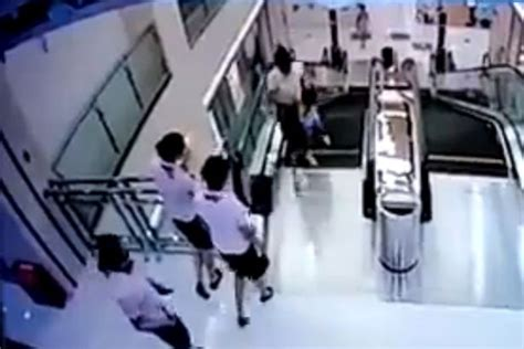 crushed by escalator mother throws son to safety before falling to death in