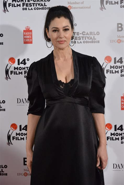 monica bellucci black dress monica bellucci flaunts her large assets in daringly