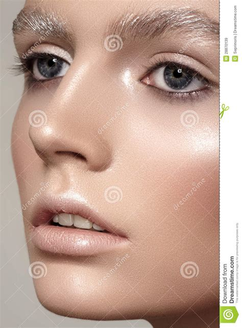 Tas Make Up Shinny beautiful fashion model with winter make up snow eyebrows shiny skin stock image