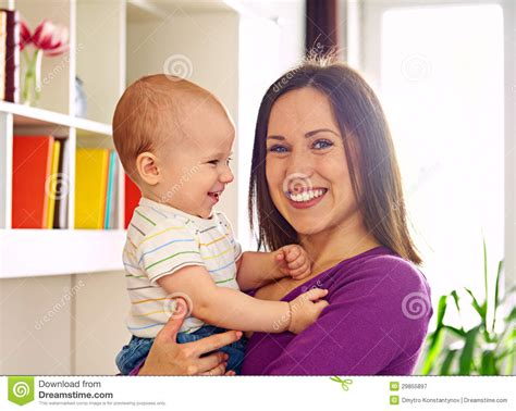 mom and son have in livingroom mother and cute son at livingroom royalty free stock