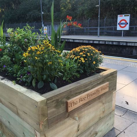 Railway Sleeper Planter by Putney Station Railway Sleeper Raised Beds