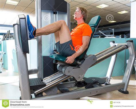 seated leg press machine workout seated leg press machine blond workout stock photo