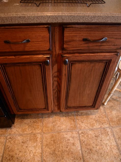 how to stain oak cabinets distressed cabinets see cate create