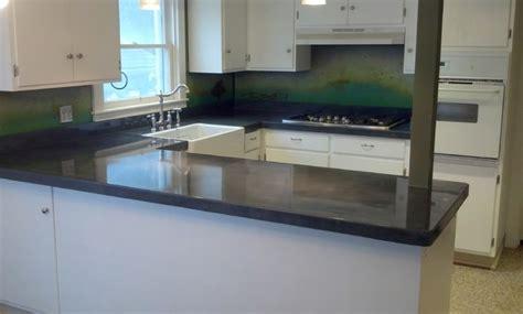 concrete countertop with steel patina backsplash