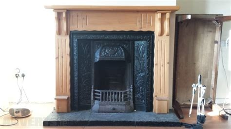 solid wood fireplace with cast iron insert for sale in