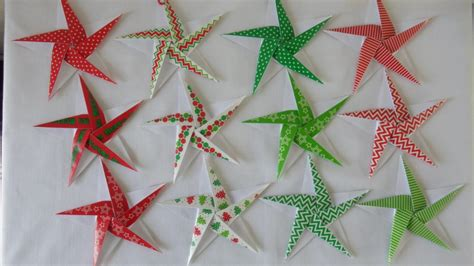printable christmas origami paper 5 pointed origami star gift tags or decorations with