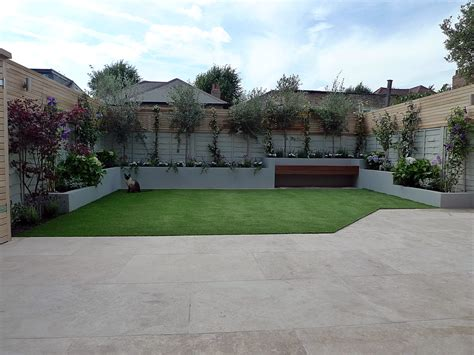 contemporary garden design ideas uk small garden design travertine paving artificial easi