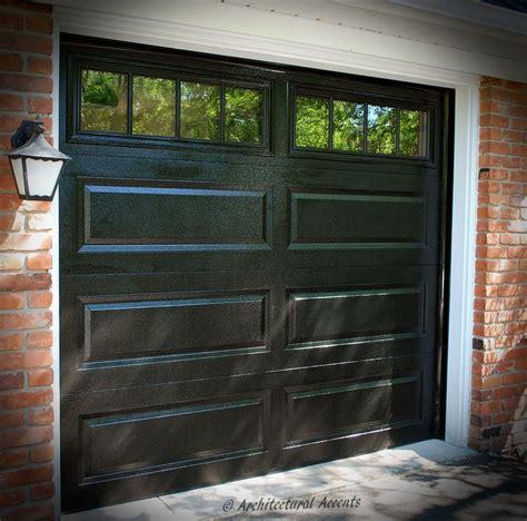 single black garage door white aluminum capping