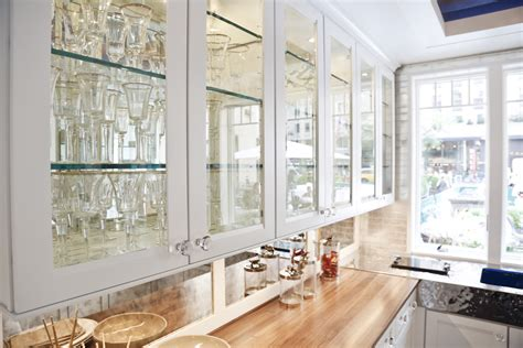 White cabinet applying clear glass for kitchen cabinet doors