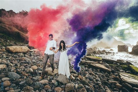color bombs engagement session with colored smoke bombs in san francisco