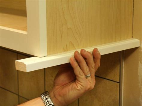 installing kitchen cabinets diy how to install a kitchen cabinet light rail how tos diy