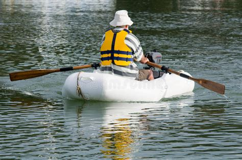 dinghy boat photos man rows dinghy boat royalty free stock photography