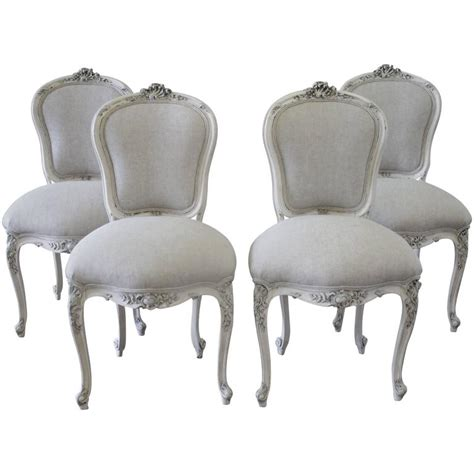 set of four antique rococo painted dining chairs at